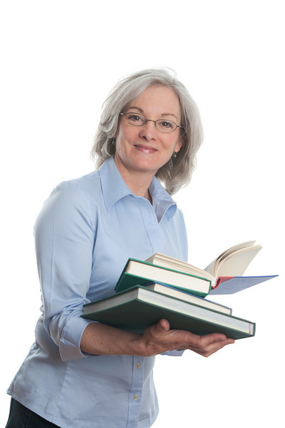 "Woman with books. <a href=""http://www.istockphoto.com/file_search.php?action=file&lightboxID=5540504"">Available for purchase from William Britten iStockphoto</a>"