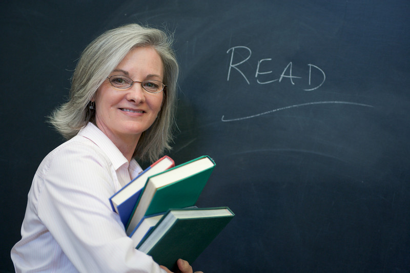 """Teacher at the blackboard. <a href=""""http://www.istockphoto.com/file_search.php?action=file&lightboxID=5540504"""">Available for purchase from William Britten iStockphoto</a>"""