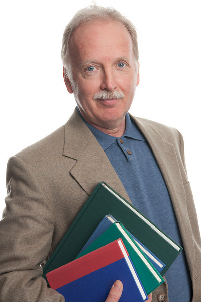 "Man with books. <a href=""http://www.istockphoto.com/file_search.php?action=file&lightboxID=5540504"">Available for purchase from William Britten iStockphoto</a>"