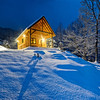Snowbound cabin at night