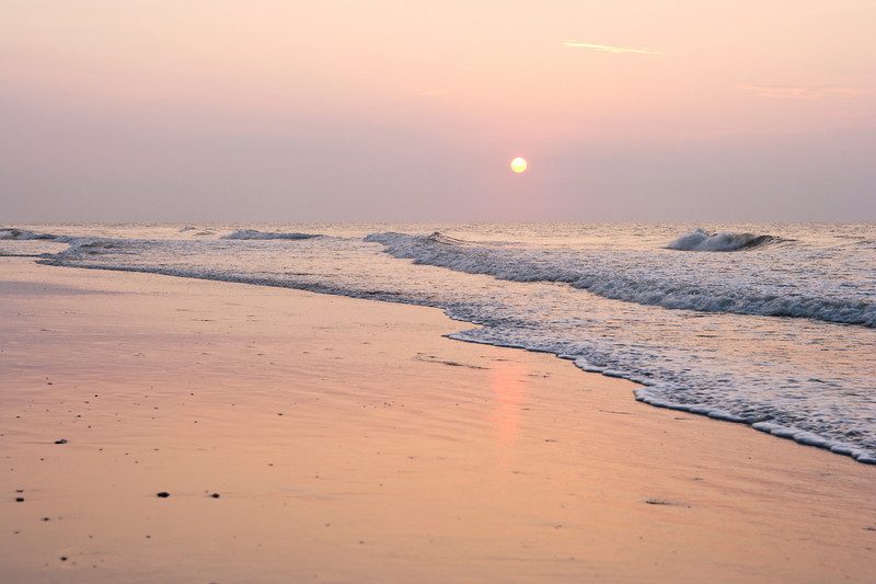 "Ocean waves on the beach with sunrise! <a href=""http://www.istockphoto.com/file_search.php?action=file&lightboxID=8618733"">Available for purchase from William Britten iStockphoto</a>"