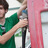 """Young teenager pumping gas. <a href=""""http://www.istockphoto.com/file_search.php?action=file&lightboxID=3914990"""">Available for purchase from William Britten iStockphoto</a>"""