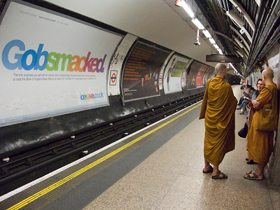 Buddhist Monks at a London's Tube Station (London, UK)