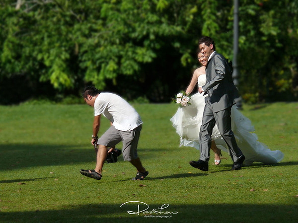 "Pity this couple - I haven't seen a cameraman getting their clients running under the hot sun. I counted 4 retakes. This ""professional"" was found wearing sandals and a round neck old man's T-shirt. Wonder how he aims correctly !!"