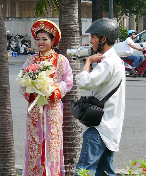Vietnamese bride - My guess was a despatch rider cum moon lighting as videographer