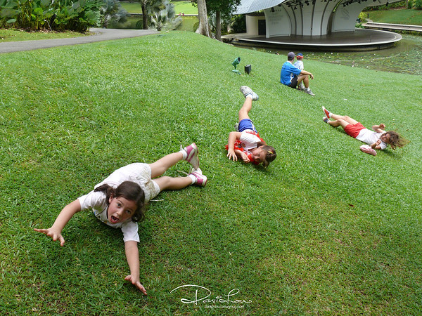 Earthquake - That bloke seems unshaken at the scale of 5. Nah, caught these girls played rolling down the slope.