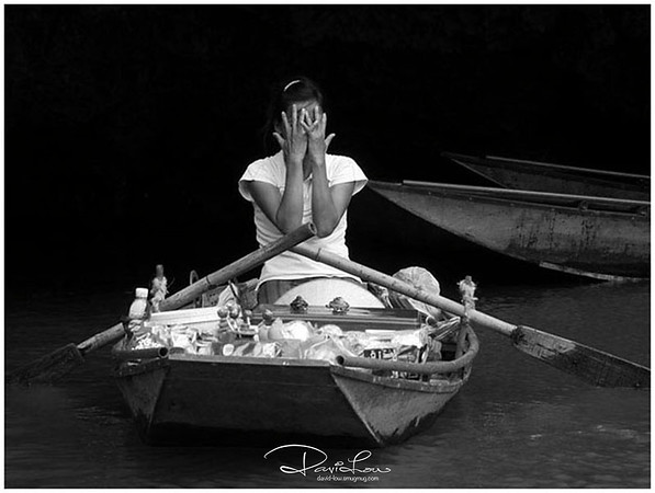 Cruising by Ngo Dong river in Vietnam, we met many river peddlers that present us many snap shots. This lady never gave me half a chance. In fact her covered-up struck me as very child-liked.