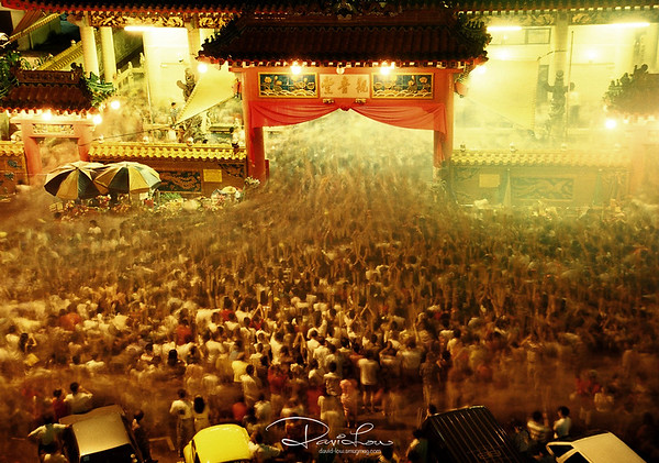 When clock strike 12 - At the precise count of  Lunar New Year midnight, the temple gate will open, resulting in the mass of devotees surging forward to plant their joss stick with the idealogy not to miss out being too late from mid-night for better blessing