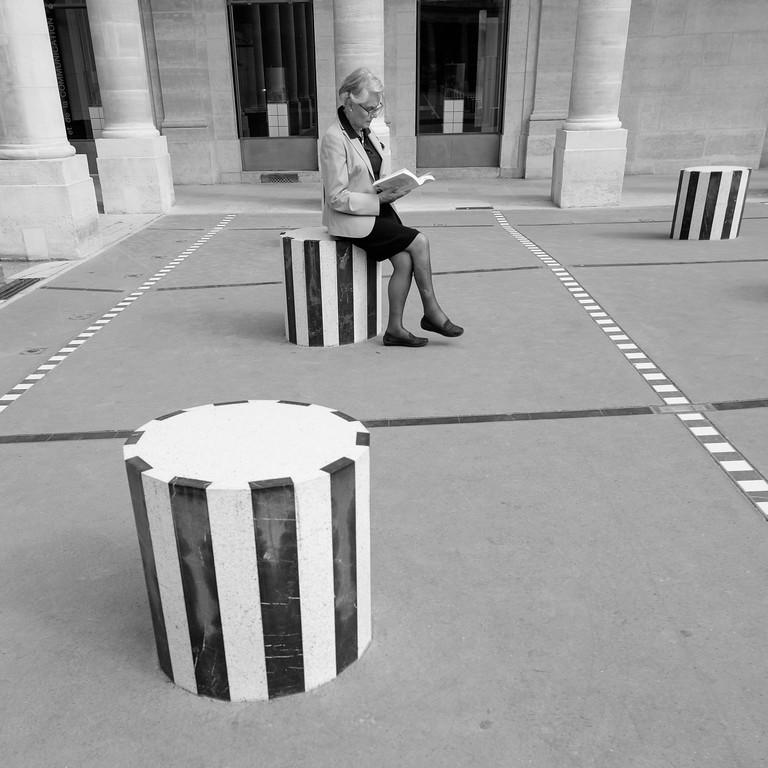 Reading a book at Palais Royal