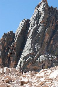 "Climbers approaching the ""Open Book"" (the prominent corner just left of center)."