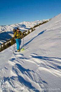 backcountry skier hikes in the pioneer mountains near ketchum and sun valley idaho.. model release.