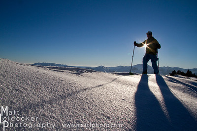 backcountry skier hikes in the pioneer mountains near ketchum and sun valley idaho.  model release.