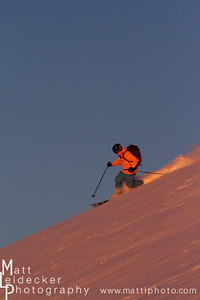 backcountry skier skiing in the pink sunset light in the pioneer mountains near ketchum and sun valley idaho.  model release.