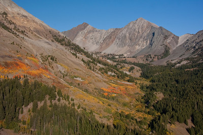 The colorful flanks of Cobb Peak stand in front of McKintyre and Jacqueline Peaks.