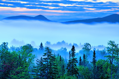 Fog covers the valley at dawn in the Adirondack Mountains