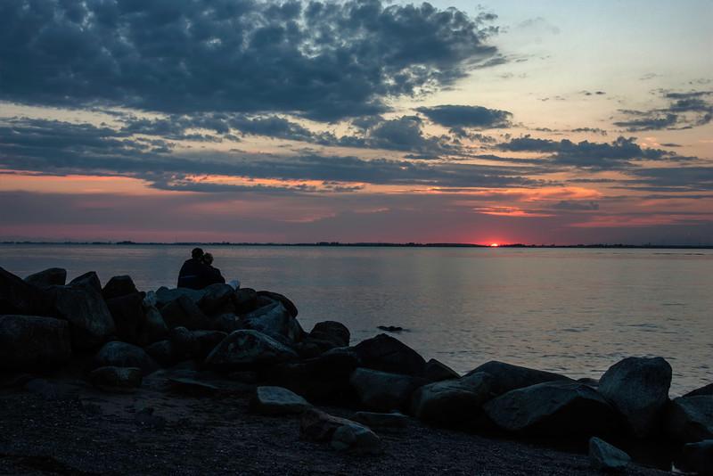 Couple enjoying the sunset at Crescent Beach,  BC