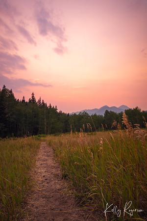 After the sun dipped below the line of site behind those mountains in the distance, the sky held onto this redish pink hue with a hint of purple. It was one of those moments you just stand there and soak in what nature puts before us. Taken during the height of wild fire season in August, American Fork Canyon, Utah.