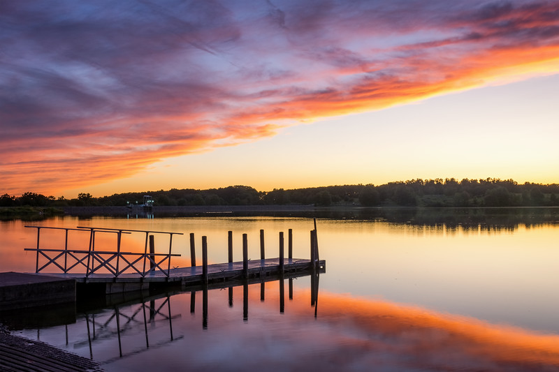 A beautiful sunset with the dock  at Montour Preserve near Washingtonville in Montour County on September 5, 2019. The clouds were the very outer edge clouds of Hurricane Dorian which was off the coast to the southeast.