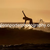 Athletic surfer in the evening sun.