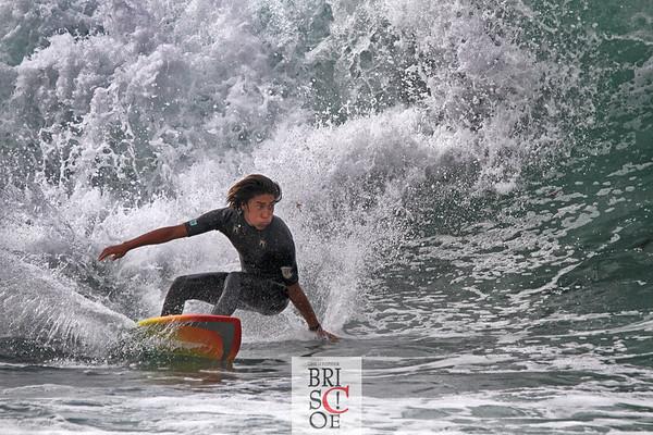 Surfer and Windansea, La Jolla, California.