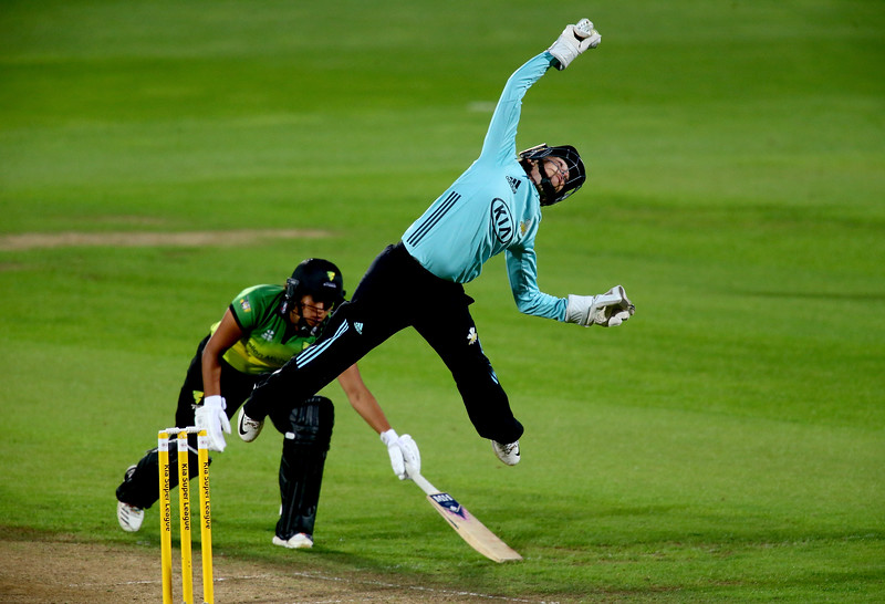 18th August - Sarah Taylor of Surrey Stars jumps to reach a catch as Naomi Dattani of Western Storm dives to make her ground during the Women's Kia Super League match between Surrey Stars and Western Storm.