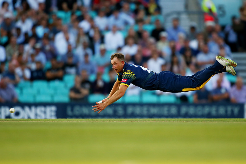 31st July - Graham Wagg of Glamorgan makes a full-length dive in an attempt to run-out Nic Maddinson of Surrey during the Vitality Blast match between Surrey and Glamorgan.