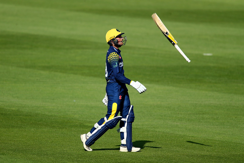 6th June - Connor Brown of Glamorgan throws his bat in the air after being dismissed on 98 caught by Jason Roy off the bowling of Rikki Clarke during the Royal London One-Day Cup game between Surrey and Glamorgan.