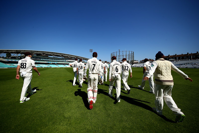 6th May - Surrey players make their way to the field to open the third day of the County Championship match against Worcestershire.