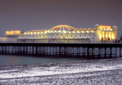 Brighton's palace Pier Illuminated on a snowy winter's evening
