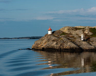 A small lighthouse on a rocky island