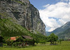 Northern view down the Lauterbrunnen Valley - with a waterfall along the steep limestone wall - canton of Bern