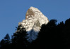 Day's first sunlight upon the eastern and northern peak faces of the Matterhorn - canton of Valais