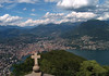From the church atop Monte San Salvadore - down to the city of Lugano, in the Canton of Ticino - with the Lepontine Alps (central alps) beyond.