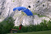 """BASE Jumper landing in the Lauterbrunnen Valley - BASE is the acronym for """"buildings, antennas, spans, earth), the structures from which they jump - in this case an """"Earth"""" jumper from the natural rock cliff above the Lauterbrunnen Valley - canton of Bern"""