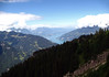 Beyond the cloud-shaded Schynige Platte - with the Thunersee (Lake Thun) in the distance - canton of Bern