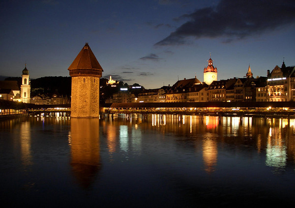Reuss River reflections, of the - Jesuit Church - Kapellbrücke (Chapel Bridge) - Wasserturm (Water Tower) - Chateau Gutsch (distal hill) - Rathausturm (Town Hall Tower) - and the top of the Luegislandturm, one of the towers forming the old fortress wall around the old city of Lucerne