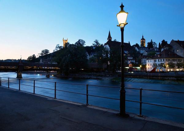Dusk across the Reuss River - to the Spreuerbrücke (Mill Bridge) - and the fortress wall towers of the Mannliturm, Luegislandturm, and Wachtturm - Lucerne