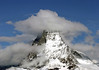 Cumulus clouds covering the western face and summit of the Matterhorn - canton of Valais