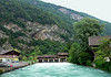 Up the Aare River - at the canal divide dam and covered bridge - with the slopes of the Harder Kulm beyond - city of Interlaken - canton of Bern