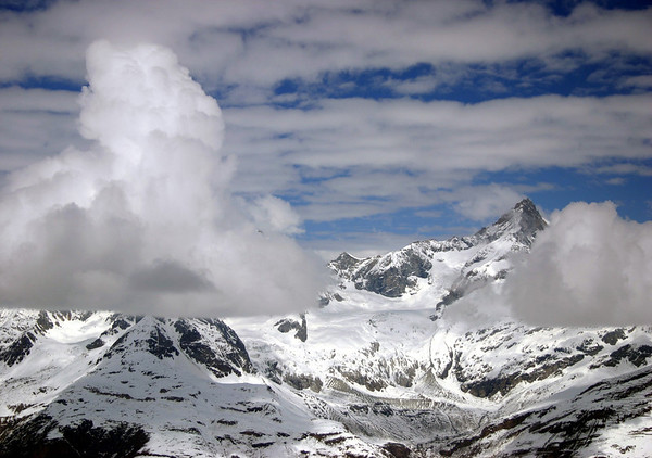 From the Gornergrat (Gorner Ridge) - past the floating cumulus clouds - to the Zinal Rothorn - canton of Valais