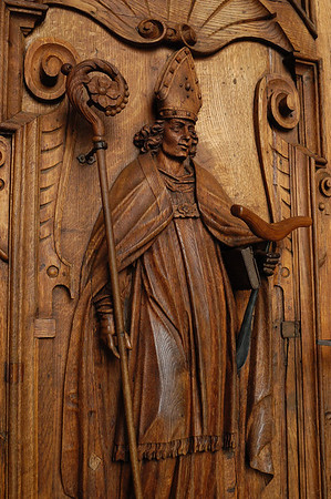 Wood carved door of a bishop - leading into the Hof Church - Lucerne