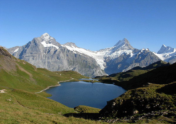 Across the Bachalpsee (Lake Bachalp), a twin level lake, along the shaded northestern slopes of the Reeti - across to the distal peaks of the Wetterhorn (L) Barglistock (LC) - Schreckhorn and Lauteraahorn (RC), and the Finsteraahorn (R) - canton of Bern
