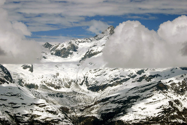 Eye level with the floating cumulus clouds - across to the peak of the Zinal Rothorn - canton of Valais