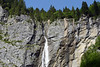 One of the dozens of snow and glacial-melt waterfalls, flowing down the Lauterbrunnen Wall, composed of sedimentary limestone - canton of Bern