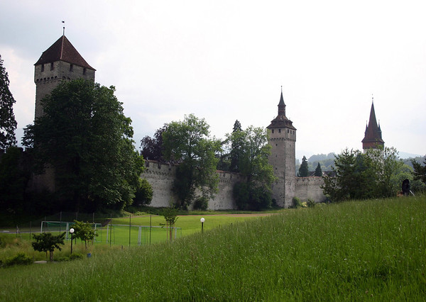 Museggmauer (Musegg Wall), the old fortress wall built from 1370-1442 - with the Zeitturm (Time Tower, L), the 144 ft. (44m) tall Wachturm (also called the Heuturm), and the Luegislandturm (Luegisland Tower, R) - Lucerne
