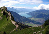 From the Obergerghorn - viewing westward along the trail to the Schynige Platte - with the city of Interlaken below - and the Thunersee (Lake Thun) beyond - and the distal pyramid-shaped peak of the Fromberghore above the drifting clouds - canton of Bern
