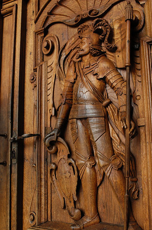 Wood carved door of a soldier - leading into the Hof Church - Lucerne
