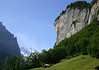 Southern view down the Lauterbrunnen Valley - with its shear limestone walls, and dozens of waterfalls flowing down its walls - to the distal northwestern face of the Grosshorn - canton of Bern