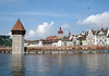Across the Reuss River - to the Wasserturm (Water Tower) and Chapel Bridge - with the City Hall Tower (clock tower and burgandy dome) and two of the old wall towers (Luegislandturm and Zeitturm) along the horizon - Lucerne