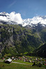 Across the village of Gimmelwald - and the Lauterbrunnen Valley - across to the Mattenbach Falls and Stadenbach Falls, flowing from below the Silberhorn and the Jungfrau, to the left of the cumulus cloud - with the Gletscherhorn and Ebnefluh, to the right - canton of Bern